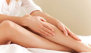 woman-applying-lotion-to-her-leg